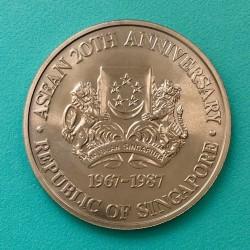 Moneta > 10dollari, 1987 - Singapore  (20° anniversario - ASEAN-Associazione delle Nazioni Del Sud-Est asiatico) - obverse